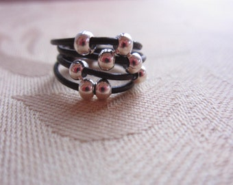 Leather cord and silver bead ring