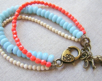 Triple Strand Beaded Bracelet in Sky Blue Coral Pink and Cream White Brass Elephant Charm  Bead Bracelet  Elephant Jewelry Boho Chic BJ0047