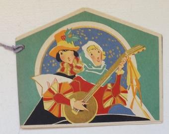 Art Deco vintage Christmas bridge tally card with madrigal singers carolers minstrels with blue tassel ephemera