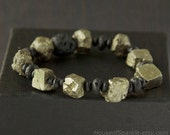 Gold pyrite and black lava bracelet. Black stone bracelet. Chunky stone bracelet. Earthy bracelet.
