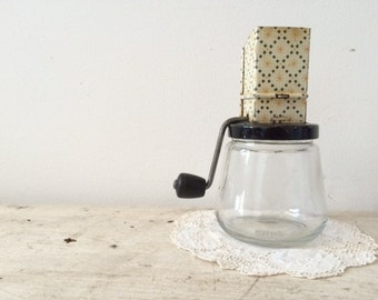 Vintage Nut Grinder with Black/Yellow/White patterns.