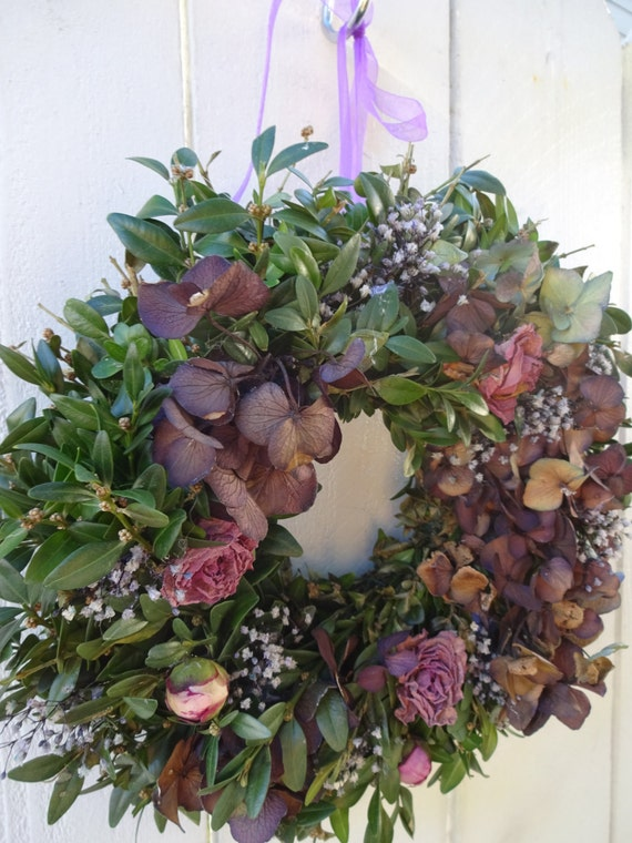 Dried boxwood wreath with preserved purple hydrangeas and