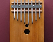 Thumb piano Kalimba - cherry body, spruce top, 8 keys