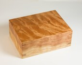 Jewelry box crafted of highly figured cherry wood.