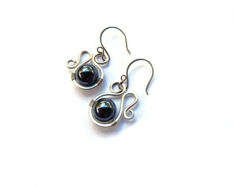 Organic swirls with hematite stones wrapped with hand formed sterling silver