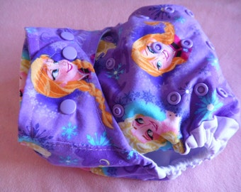 SassyCloth one size pocket diaper with Frozen sisters print. Made to order.