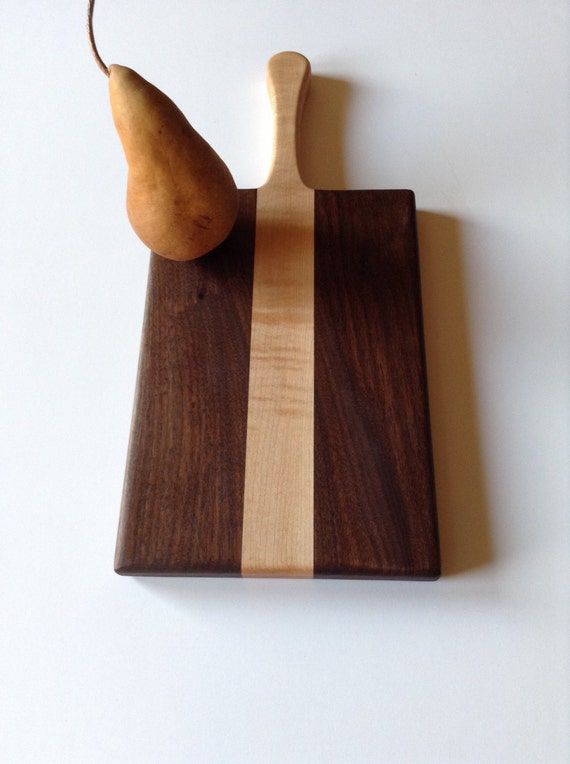 Wooden Cutting Board With A Hand Carved Handle Made From Black