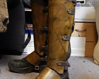 Gladiator luxury greaves (leg protection) with battle damage. SCA, LARP