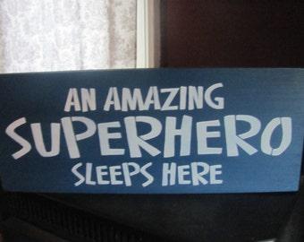 An Amazing Superhero Sleeps Here sign for boys room gift