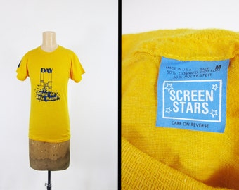 Vintage 80s Screen Stars T-shirt Day 4 Reigns on the Mount Yellow - Small / Medium