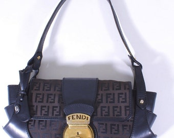 FENDI brown compilation clutch bag with gold tone hardware and FF canvas pattern - OFFERS