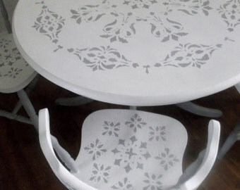 """Bespoke dining room table & chairs painted in Annie Sloan's """"old white"""" with stenciled details."""
