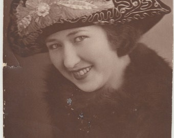 Vintage/Antique close up photo of a woman wearing a beautiful hat