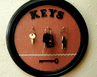 Key rack from recycled vintage picture frame with laser cut wood lettering and key