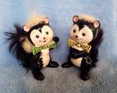 Vintage kitsch stinking cute little pair of Japan skunk figurines