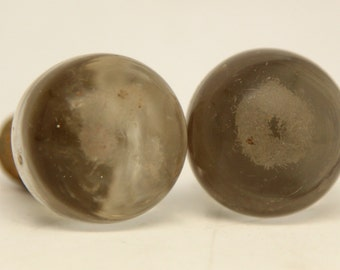 Pair of round slightly worn cork stoppers