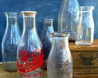 Vintage glass embossed milk bottle