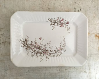 Antique medium ironstone platter with a floral transferware pattern