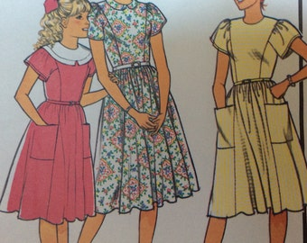 Style 4630 tween girls sewing pattern, girls dress pattern size 10, size 12, size 14, princess line dress with flared skirt classic style