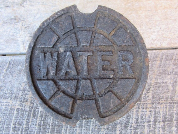 Vintage cast iron water line lid pipe cap company