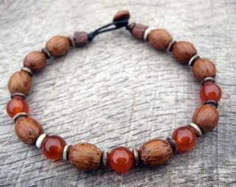 Mens bracelet, red carnelian, wood and bone beads, tribal surfer style, natural materials on strong cord, toggle and loop clasp, handmade