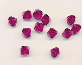 Twelve sparkling Swarovski crystals in the discontinued shape 5301: 10 mm - fuchsia