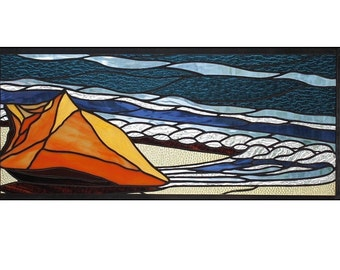 Stained glass panel of shell and ocean waves in colors of blue and orange