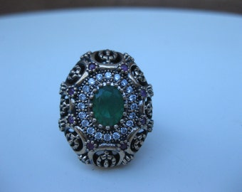 silver with gold filling intricate design coctail ring with semi-precious stones