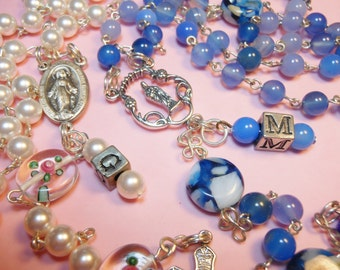 Personalize your rosary with matching beaded initial charm add on