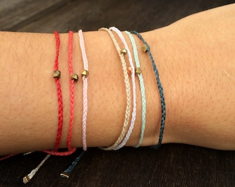 Wax braided friendship bracelet with brass beaded detail: one size fits all
