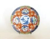 Takahashi Round Porcelain Decorative Plate, Scalloped Asian Plate