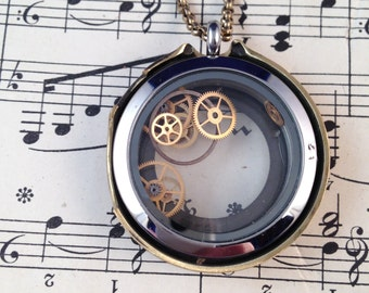 Steampunk locket filled with tiny gears.  Ultra Rad!