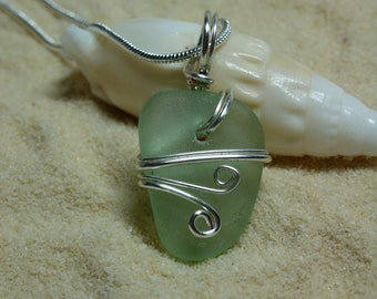 Drilled and wire wrapped seafoam green sea glass necklace with sterling silver chain
