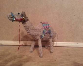 A camel for your nativity scene, hand knitted.  With bells and beads!