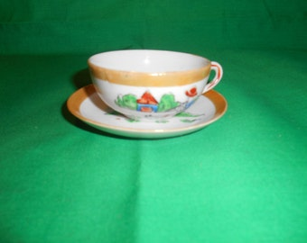 One (1), Porcelain Child's Teacup and Saucer, from Post War Japan.