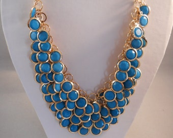 4 Strand Turquoise Color Bib Necklace on a Gold Tone Chain