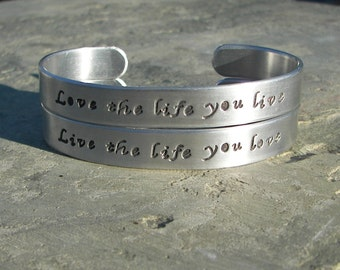Hand Stamped Aluminum Cuff Bracelet Set Live the life you love.  Love the life you live Set of two