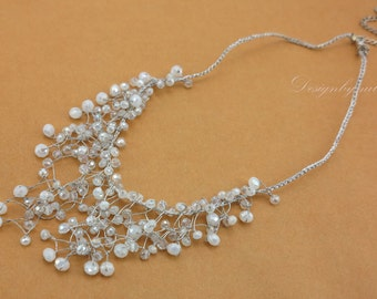 White crystal hand knotted on silk necklace.