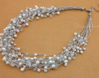 white freshwater pearl multi strand necklace.