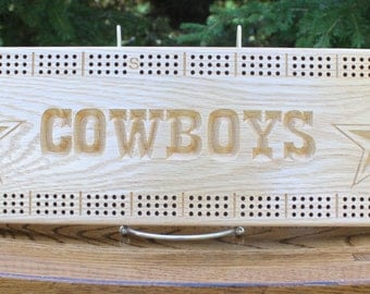 Dallas Cowboys cribbage board made from Solid Oak wood.