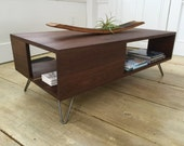Fat Boy mid century modern coffee table with storage, featuring black walnut & hairpin legs.