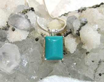 12x10 5ct. Genuine Sleeping Beauty Turquoise Pendant set in Solid 925 Sterling Silver