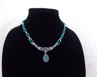 Serenity...sterling silver and teal green beads make this necklace feel very soothing.
