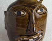 Amber celadon face jug- a bit of folk art!