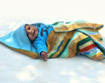 Crocheted hooded striped baby blanket with white lining custard blue green