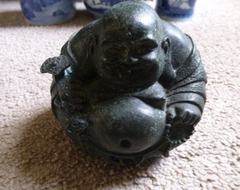 Amazingly detailed bronze Hotei - Laughing Buddha statue - round robed figure holding Lotus flower in relief