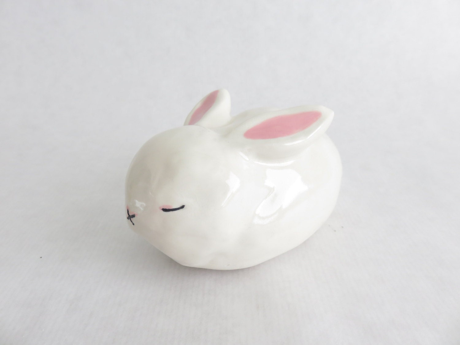 rabbit ceramics and pottery white bunny sculpture slepping