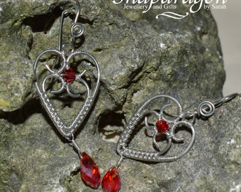 Ornate vintage style wire wrapped heart earrings with red crystal drops