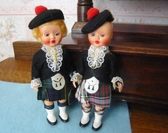 Vintage Pair of Scottish Dolls in Authentic Tartan  Costumes  and Sleeping Eyes 6 1/2 Inches Made in Gt. Britian