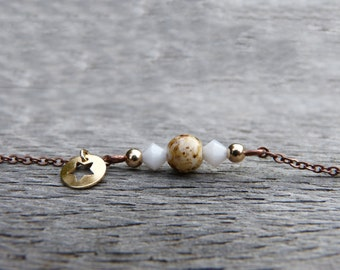 Copper Bracelet on a thin chain, with a vintage round bead, 2 white swarovski crystals, 2 round gold platted beads, a little glass bead